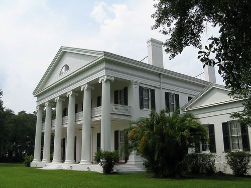 Madewood Plantation House, a white, two story house with Corinthian pillars